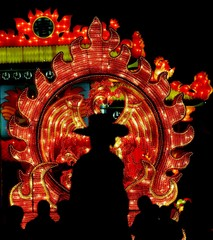South Koreans look at a large Chinese lantern at the World of Lights Expo 2005 in Ilsan, north ...