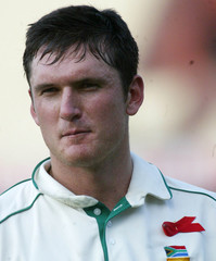 South African captain Graeme Smith wearing the globally recognized AIDS symbol red badge in Calcutta.