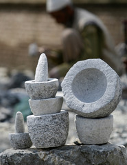 Kitchen items made of stone are displayed in Panthachowk