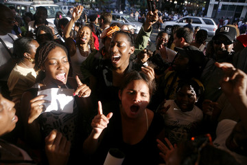 Michael Jackson fans sing and dance outside the Apollo Theatre in New York