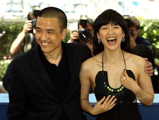 "Chinese director Lou Ye (L) and Chinese actress Zhang Ziyi (R) laugh during a photocall for ""Purple .."