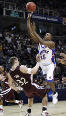 Kansas Jayhawks' Mario Chalmers goes to the net against Southern Illinois Salukis Matt Shaw in their NCAA men's West Regional semi-final basketball game in San Jose