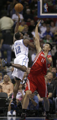 Orlando Magic center Dwight Howard shoots over Houston Rockets center Yao Ming.