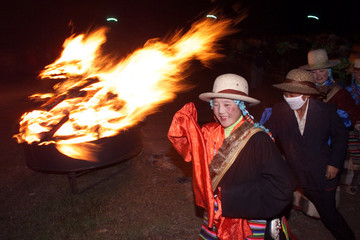 TIBETANS DANCE TO DISCO MUSIC DURING BONFIRE PARTY IN NAKCHU.