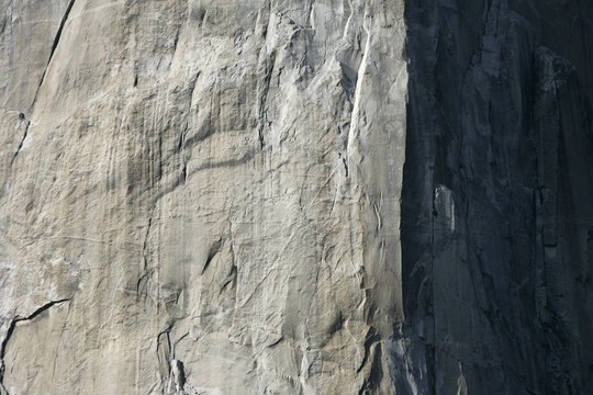 Rock climber ascends El Capitan, one of world's largest granite monoliths, in Yosemite Valley at Yosemite National Park in California