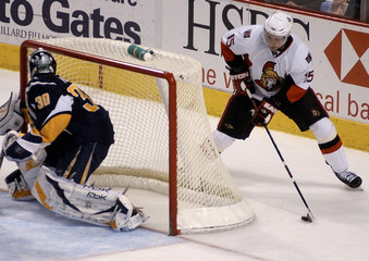Sabres goaltender Ryan Miller is caught looking the wrong way as Ottawa Senators left winger Dany Heatley attempts a wraparound during their NHL hockey action in Buffalo