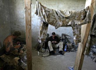 British soldiers clean their weapons at Sangin camp in the southern province of Helmand