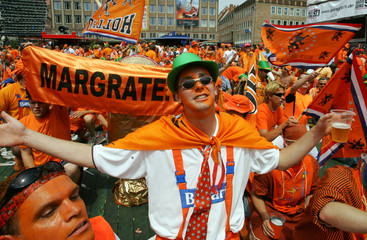 Dutch soccer fans cheer before between the Netherlands and Portugal in Nuremberg