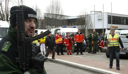 Police and paramedics gather outside Albertville-Realschule school where a shooting incident took place in Winnenden