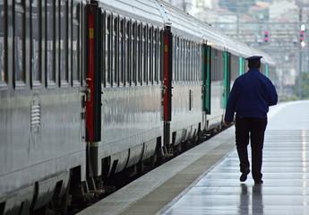 Employee of French state-run railroads SNCF walks on an empty platform in Marseille's railway station