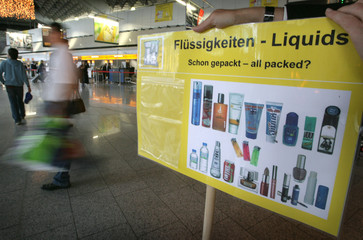 A sign with samples for the new security rules for hand luggage are displayed in hall A at Frankfurt airport