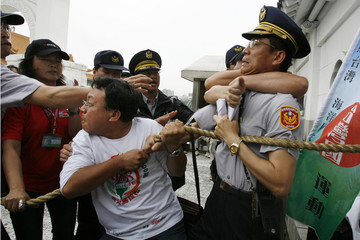 Pro-Taiwan independence activists scuffle with policemen outside the Chiang Kai-shek Memorial Hall in Taipei