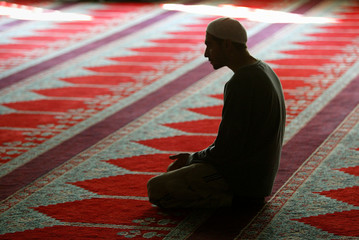 MUSLIM PRAYS AT CENTRAL MOSQUE IN HAMBURG.