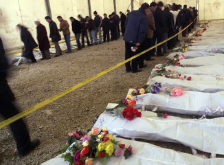 Relatives file past returned remains of 44 ethnic Albanians killed in Kosovo.