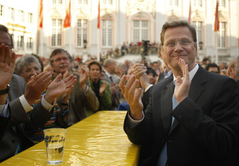Westerwelle, leader of the pro-business Free Democratic Party applauds during an election campaign rally in Bonn