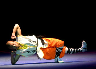 SHAOLIN MONKS DEMONSTRATE THEIR SKILL DURING A SHOW IN BARCELONA.