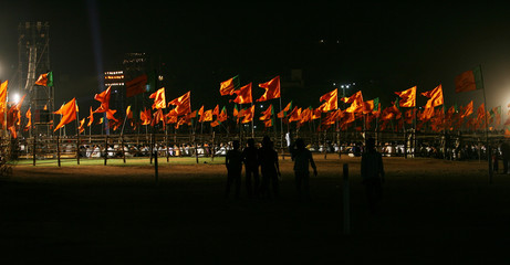 Flags are displayed during a joint election rally of India's main opposition BJP and Hindu hardline party Shiv Sena in Mumbai