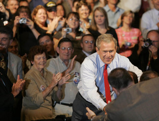 US President George W Bush greets supporters in Columbus Ohio.
