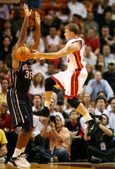 Miami Heat's Williams passes under the basket against New Jersey Nets in Miami