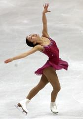USA KWAN CELEBRATE'S FOLLOWING WINNING SKATE AT WORLD CHAMPIONSHIPS.