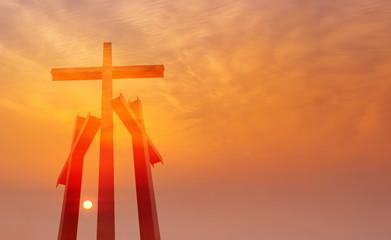 Three crosses over sunset background
