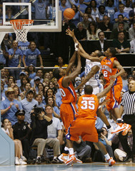University of North Carolina's Quentin Thomas goes up for the tying basket in regulation against Clemson University in Chapel Hill