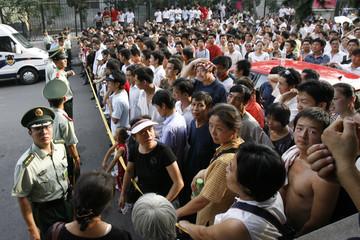 Paramilitary policemen cordon the crowd near Tiananmen Square in Beijing