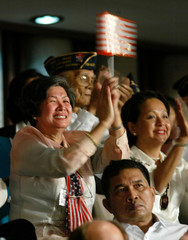 BUSH SUPPORTERS APPLAUD DURING HIS SPEECH TO THE NATIONAL CONGRESS INMANILA.