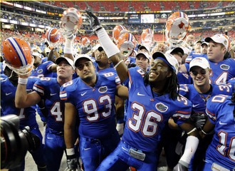 University of Florida players celebrate their win against University of Alabama in Atlanta