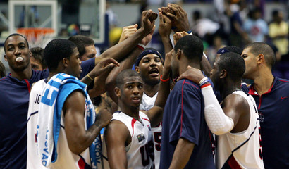 U.S. players gather to celebrate after defeating Italy during the first round of the world basketball championships in Sapporo