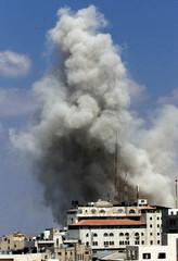 SMOKE RISES FROM BUILDINGS INSIDE PALESTINIAN PRESIDENT YASSER ARAFAT'SCOMPOUND IN RAMALLAH.