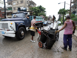 A truck with speakers drives through the streets of Havana encouraging Cubans to clean up the debris ...