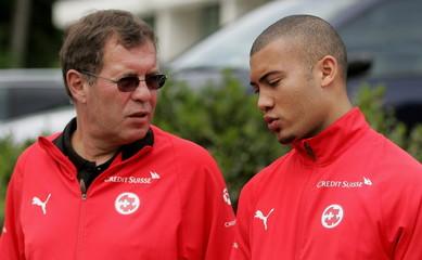 Swiss forward Johan Vonlanthen (R) talks to physician Ruedi Roder during a walk in Feusisberg, Switz..