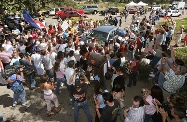 Michael Jackson fans crowd around car of Jackson's lawyer Thomas Mesereau Jr. at the entrance of ...