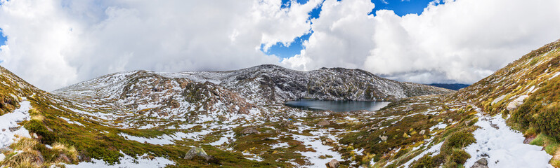 Beautiful Panorama of Blue Lake and snow covered mountains. Kosciuszko National Park, Australia