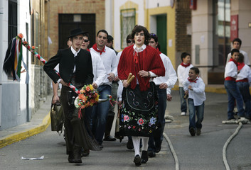 Young men parade during the feast of Saint Paul in central Spain