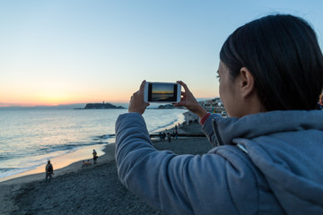 Woman taking photo in Shonan