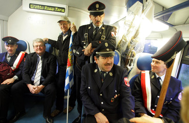 German firemen of Pentling fire brigarde sit in train on their way to Rome for inauguration of ...