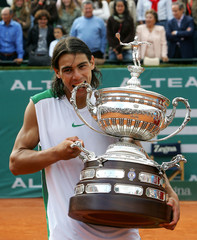 Spanish tennis player Nadal bites the trophy after winning the Barcelona Open tournament in Spain
