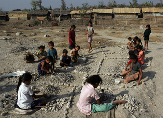 Bhutanese refugee children crack stones in the Timai refugee camp in eastern Nepal.