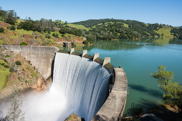 Barrage Water spills over the top of Englebright Dam on the Yuba River. A larger than normal snowpack in the Sierra Nevada Mountains has increased runoff into lakes and rivers in California.