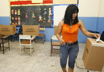 A woman casts her ballot during a referendum on expanding the Panama Canal in Panama City
