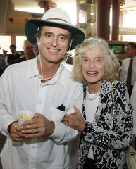 "Founder of the Special Olympics Eunice Kennedy Shriver and her son Robert ""Bobby"" Shriver pose before the opening ceremony of the Special Olympics World Summer Games in Shanghai"