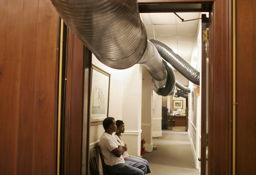 Temporary air conditioning ducts run through an office in New Orleans