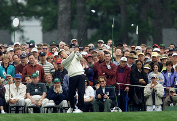 JACK NICKLAUS HITS OFF THE FIRST TEE DURING MASTERS PLAY.