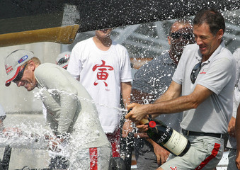 Luna Rossa's crew members celebrate after winning Louis Vuitton Act Five in Valencia.