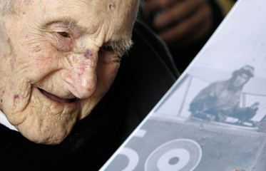 File photo shows the world's oldest man, Henry Allingham, during his 113th birthday party at HMS President in London
