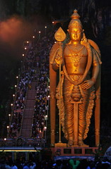 The gold colour giant statue of the Hindu Lord Muruga stands at Malaysia's 272-step Batu Caves templ..