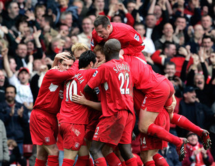 Liverpool's Kewell is mobbed by team mates after his goal against Everton during their English Premier League match in Liverpool