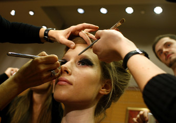 A model has makeup applied during designer Kati Zoob's 2009 spring/summer fashion show in Budapest